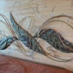 Copper and bronze headboard.