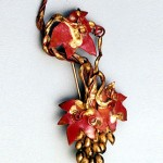 Detailed Coppered and bronze Grapevine Pin.