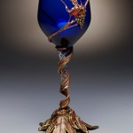 Custom copper and bronze goblet with blue glass.
