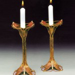 Copper and bronze candle holders.